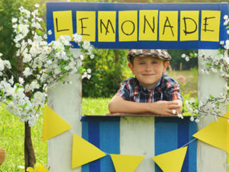 child entrepreneur selling lemonade