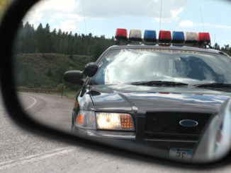 police care in rear view mirror - SR22