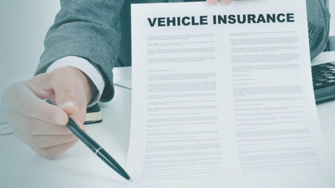 first auto insurance policy - agent with contract