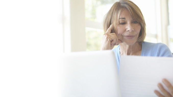 woman reviewing life insurance policy