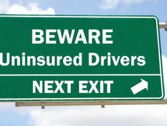 uninsured drivers road sign