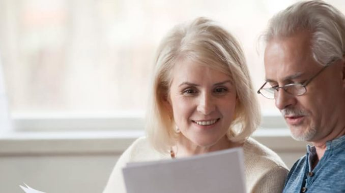 senior couple looking at insurance premiums