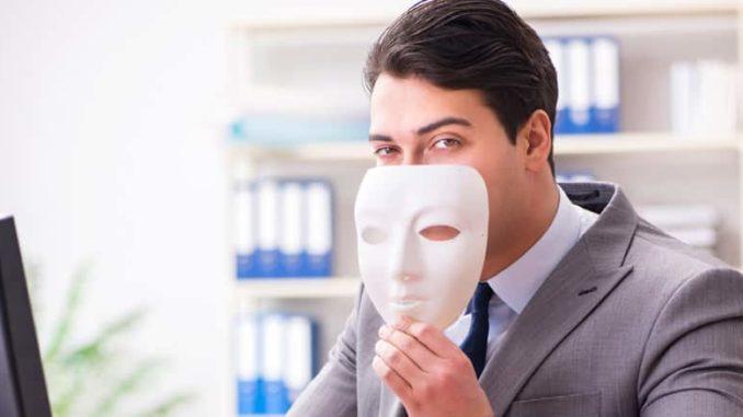 insurance fraud agent at desk