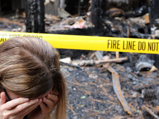 home inventory woman crying in front house fire